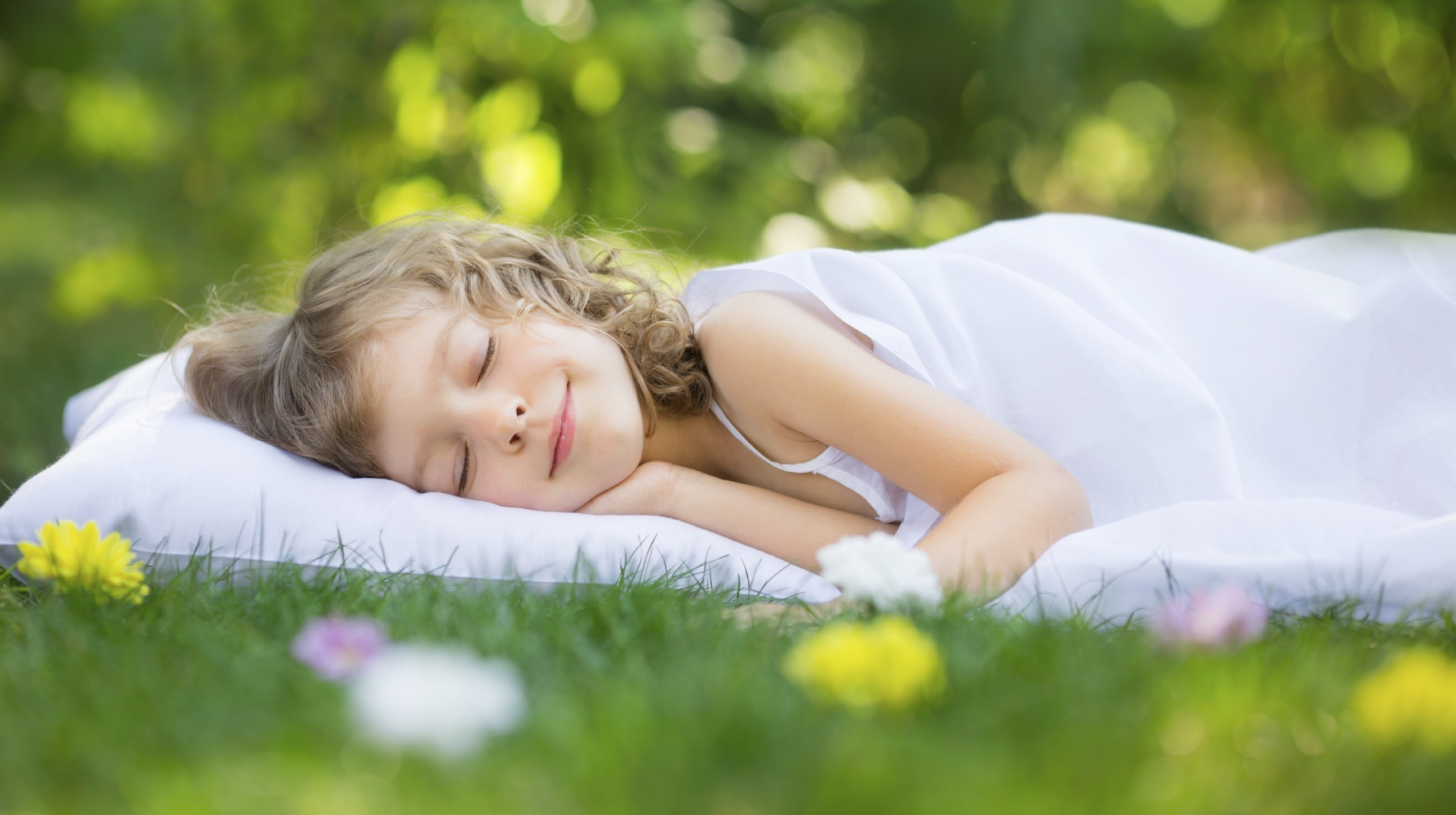 girl-sleeping-on-grass-e1421424320311